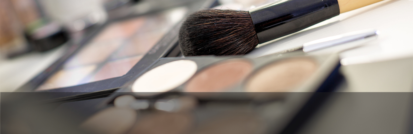 Closeup of cosmetics and brush